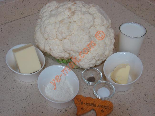 Fırında Beşamel Soslu Karnabahar Graten İçin Gerekli Malzemeler :  <ul> <li>1 adet orta boy karnabahar</li>         <li>Tuz</li>         <li><strong>Beşamel Sos İçin:</strong></li>         <li>2 yemek kaşığı tereyağ</li> <li>2 yemek kaşığı un</li> <li>2 su bardağı süt</li>  <li>Tuz</li> <li>Karabiber</li>         <li><strong>Üzeri İçin:</strong></li> <li>Rendelenmiş kaşar peynir</li>         <li>1 tatlı kaşığı tereyağ</li> </ul>