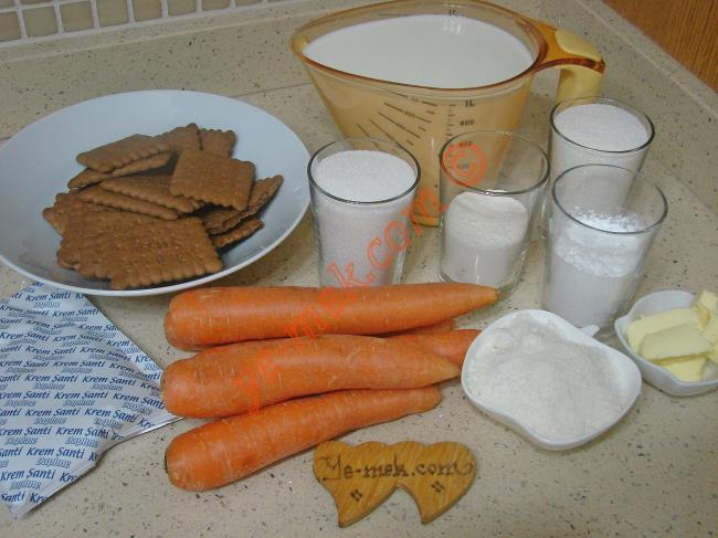 Muhallebili Havuç Tatlısı İçin Gerekli Malzemeler :  <ul> <li><strong>Havuçlu Taban İçin:</strong></li>         <li>5 adet orta boy havuç</li> <li>1/2 su bardağı toz şeker</li> <li>1/2 paket kakaolu petibör bisküvi</li>         <li>4 yemek kaşığı hindistan cevizi</li> <li><strong>Muhallebisi İçin:</strong></li>         <li>5,5 su bardağı süt</li>         <li>1 su bardağı toz şeker</li>         <li>1/2 su bardağı un</li>         <li>1/2 su bardağı nişasta</li>         <li>2 yemek kaşığı hindistan cevizi</li>         <li>1 yemek kaşığı tereyağı</li>         <li><strong>Üzeri İçin:</strong></li>         <li>1 paket toz krem şanti</li>         <li>1 çay bardağı soğuk süt</li>  </ul>