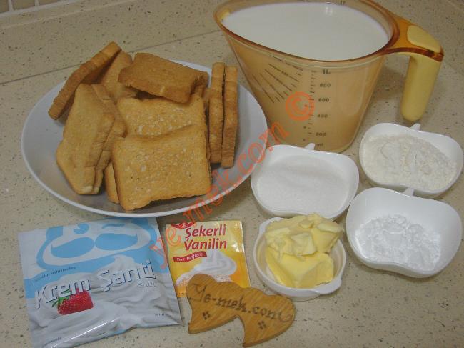 İki Katlı Etimek Tatlısı İçin Gerekli Malzemeler :  <ul>              <li>18 adet tuzsuz etimek</li>       <li><strong>Muhallebisi İçin:</strong></li>       <li>1 litre süt</li>       <li>6 yemek kaşığı toz şeker</li>       <li>6 yemek kaşığı un</li>       <li>2,5 yemek kaşığı nişasta</li>       <li>1 yemek kaşığı tereyağı</li>       <li>1 paket vanilya</li>       <li><strong>Şerbeti İçin:</strong></li>       <li>2 su bardağı toz şeker</li>       <li>2,5 su bardağı su</li>       <li>3 damla limon suyu</li>       <li><strong>Üzeri İçin:</strong></li>       <li>1 paket toz krem şanti</li>       <li>1 su bardağından 1 parmak eksik soğuk süt</li>         </ul>