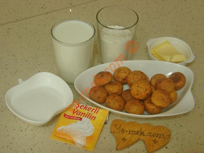 Kremalı Kemalpaşa Tatlısı İçin Gerekli Malzemeler :  <ul> <li>1 paket kemalpaşa tatlısı</li>         <li><strong>Muhallebisi için:</strong></li>         <li>2 su bardağı süt</li>         <li>1/2 çay bardağı toz şeker</li>         <li>2,5 yemek kaşığı tepeleme un</li>         <li>1 yemek kaşığı tereyağı</li>         <li>1/2 paket vanilya</li> </ul>