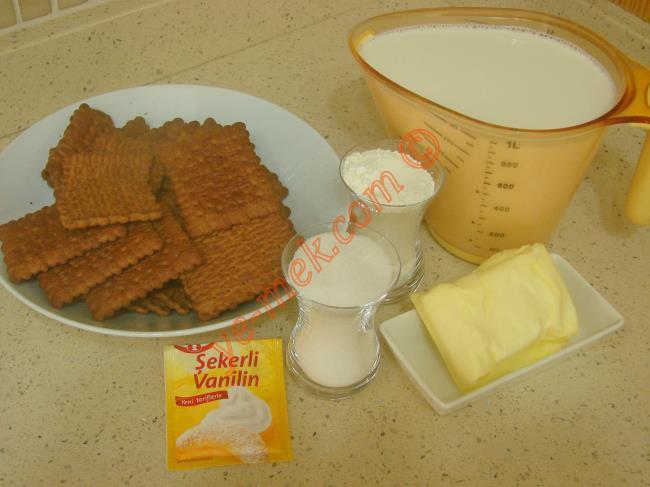 Bisküvili Paşa Sarması İçin Gerekli Malzemeler :  <ul> <li>1,5 paket kakaolu petibör bisküvi</li>         <li>Orta dövülmüş ceviz ya da fındık</li>         <li><strong>Muhallebisi İçin:</strong></li>         <li>1 litre süt</li> <li>2 çay bardağı toz şeker</li> <li>3 çay bardağı un</li>         <li>1 yemek kaşığı tepeleme tereyağı</li> <li>2 paket vanilya</li> </ul>