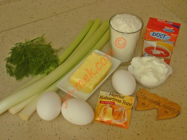 Pırasalı Kiş İçin Gerekli Malzemeler :  <ul> <li>125 gr tereyağı (Oda ısısında)</li> <li>1 adet yumurta</li>         <li>3 yemek kaşığı yoğurt</li> <li>1 çay kaşığı tuz</li> <li>1 çay kaşığı kabartma tozu</li> <li>2,5 su bardağı un</li> <li><strong>Malzemesi İçin:</strong></li> <li>4 sap pırasanın beyaz kısmı</li> <li>3 yemek kaşığı zeytinyağı</li>         <li>Az miktar tuz, karabiber</li>         <li><strong>Sos İçin:</strong></li>         <li>2 adet yumurta</li>         <li>1 kutu sıvı krema (200 ml)</li>         <li>1/2 çay bardağı süt</li>         <li>1 tutam dereotu</li>         <li>Az miktar tuz, karabiber</li>         <li><strong>Üzeri İçin:</strong></li>         <li>Rendelenmiş kaşar peynir</li> </ul>