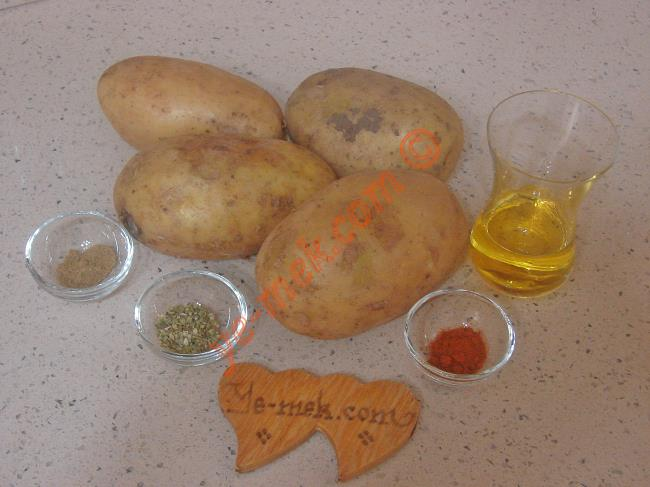 Fırında Patates İçin Gerekli Malzemeler :  <ul> <li>4 adet orta boy patates</li> <li>4 yemek kaşığı zeytinyağı</li>         <li>Tuz, kekik, kırmızı toz biber, kimyon</li> </ul>