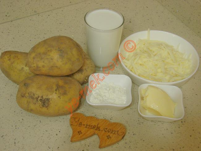 Fırında Beşamel Soslu Patates İçin Gerekli Malzemeler :  <ul> <li>4 adet orta boy patates</li>         <li>2 su bardağı süt</li>         <li>2 yemek kaşığı un</li>         <li>1 yemek kaşığı dolusu tereyağı</li>         <li>Tuz, karabiber</li>         <li><strong>Üzeri İçin:</strong></li>         <li>Rendelenmiş kaşar peynir</li>         <li>Kırmızı toz biber</li>  </ul>