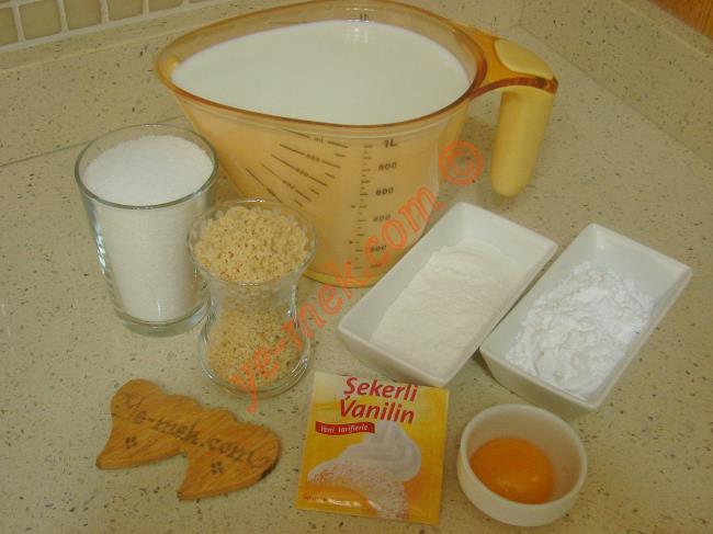 Fındıklı Keşkül İçin Gerekli Malzemeler :  <ul>          <li>1 litre süt</li>         <li>1 su bardağı toz şeker</li>         <li>3 yemek kaşığı nişasta</li>         <li>2 yemek kaşığı pirinç unu</li>         <li>1 adet yumurta sarısı</li>         <li>1 paket vanilya</li>         <li>1 çay bardağı ince dövülmüş fındık</li> </ul>